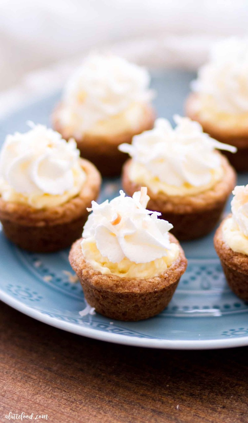 coconut cookie cups baked in graham cracker crust on a blue plate
