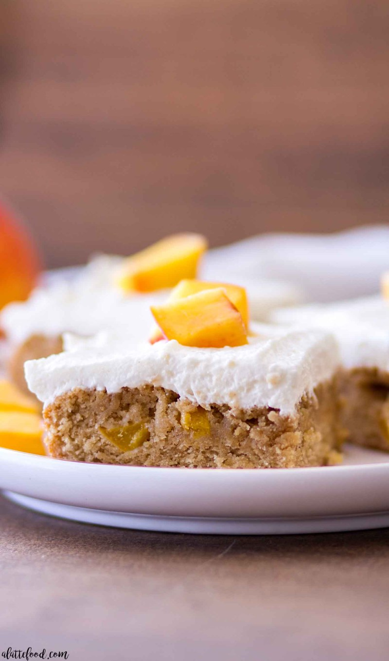 peach blondies with whipped cream frosting