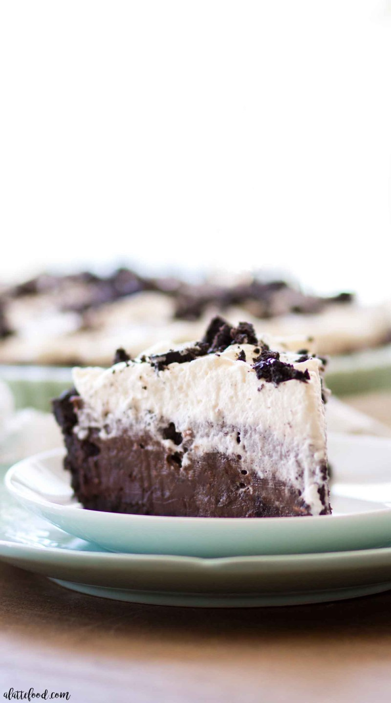 slice of no bake oreo chocolate cream pie on blue plate