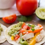 Easy Sheet Pan Chicken Fajitas -- side view chicken fajitas on corn tortillas