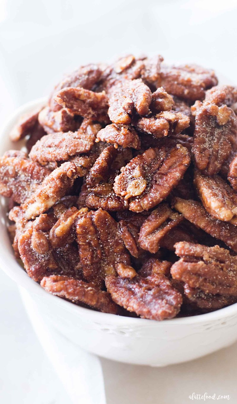 maple candied pecans in a white bowl