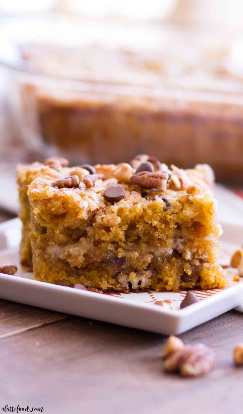 This Easy Pumpkin Earthquake Cake is one of the best fall dessert recipes! Doctored up cake mix is swirled with a cream cheese filling, making a rich, gooey pumpkin cake that's 100% over-the-top and downright delicious.#pumpkin #cake #fall #dessert #recipe