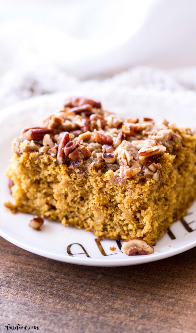 pumpkin coffee cake with crumb cake topping on white plate