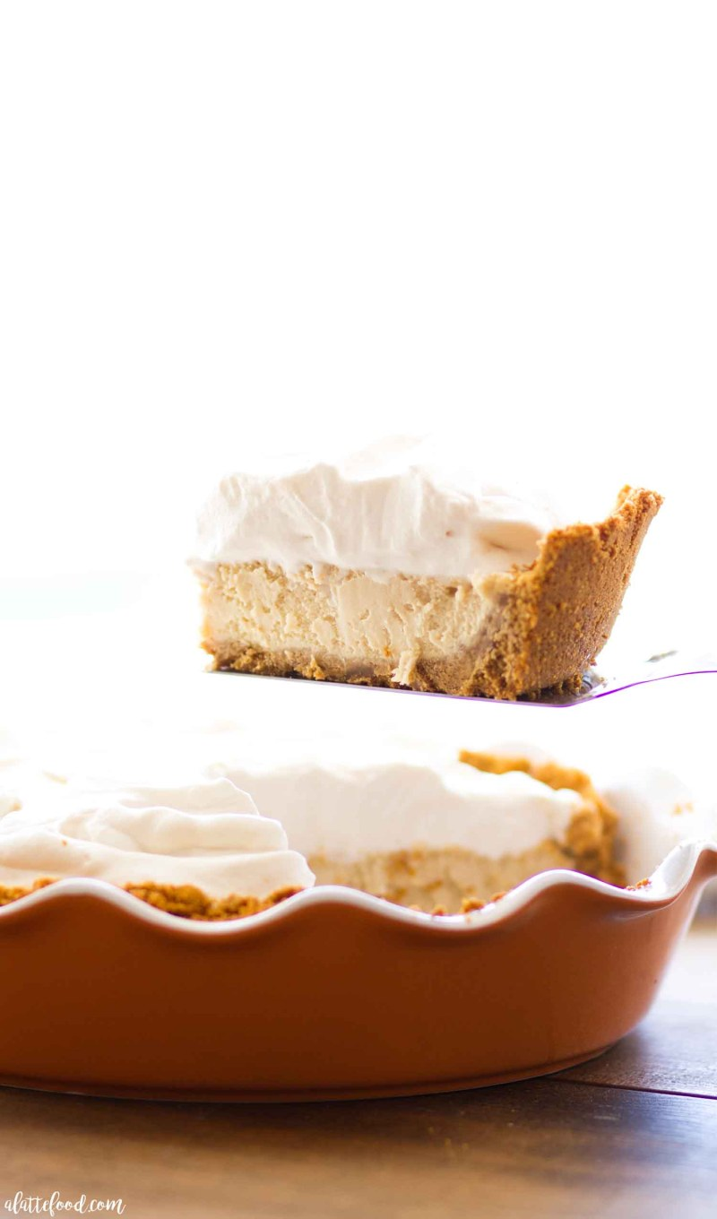 Homemade Caramel Cheesecake with a pecan graham cracker crust and caramel whipped cream.
