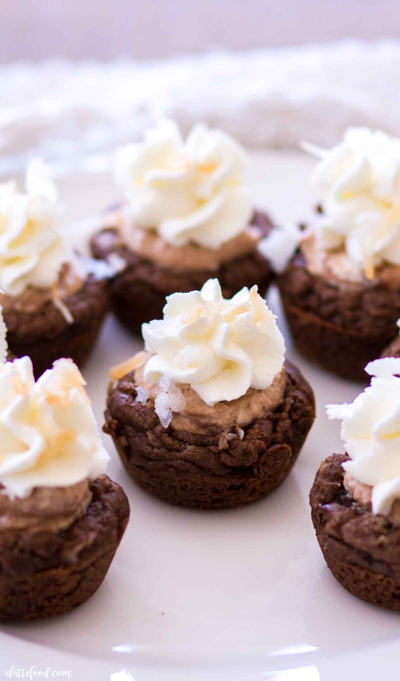 Homemade Chocolate Coconut Cream Pie Cookie Cups with stabilized whipped cream and toasted coconut.