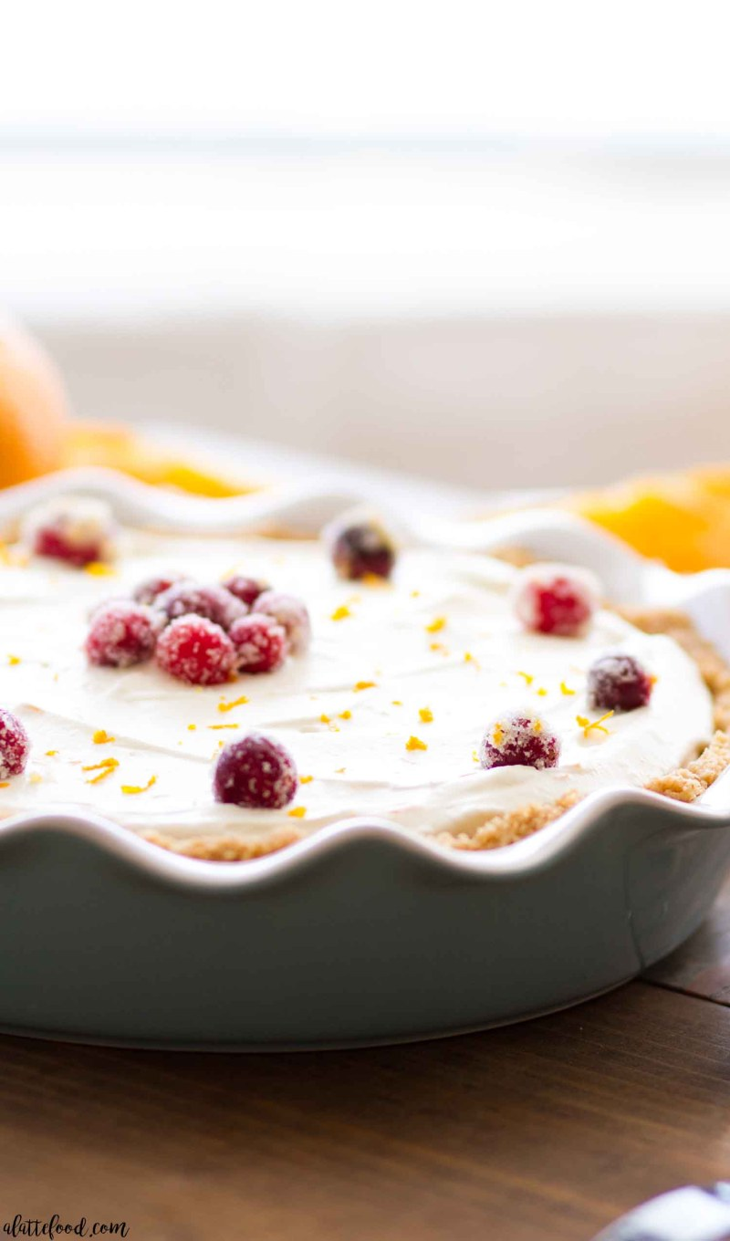Homemade cranberry pie meets orange cream pie in this no bake cranberry orange cream pie.