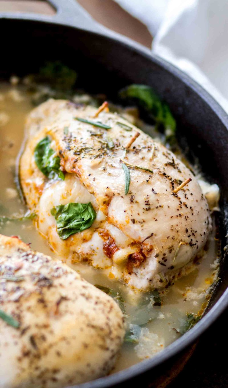 Stuffed Tuscan Chicken Breasts in a light spinach cream sauce.