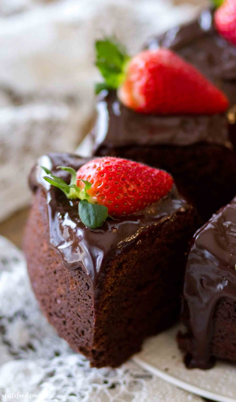 A slice of easy chocolate bundt cake with ganache and strawberries makes an easy Valentine's Day dessert.