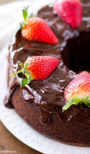 chocolate pound cake with ganache and fresh strawberries