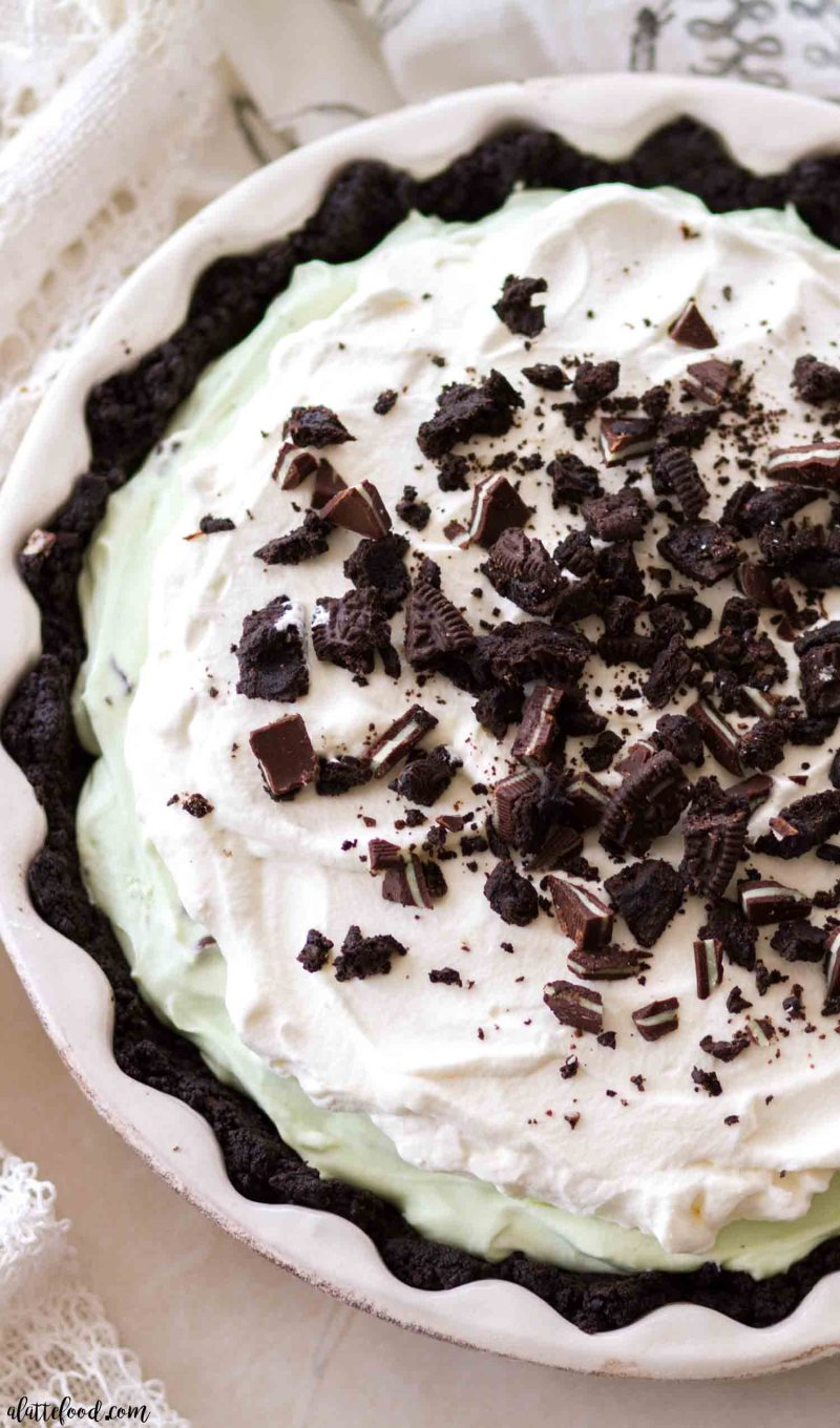 Homemade chocolate mint pie recipe with layers of homemade whipped cream, mint filling and chocolate ganache
