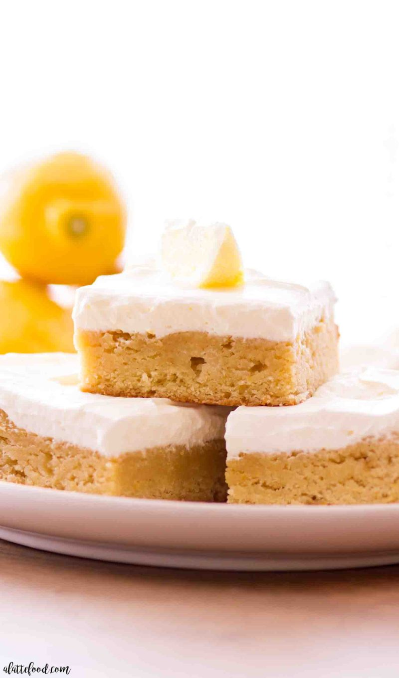 Homemade lemon blondies with a homemade lemon whipped cream frosting