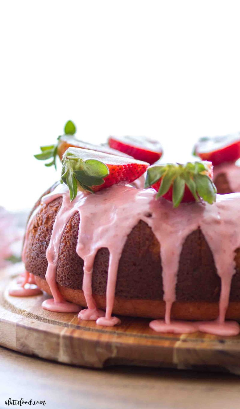 Easy strawberry bundt cake made without cake mix and topped with a homemade strawberry glaze.