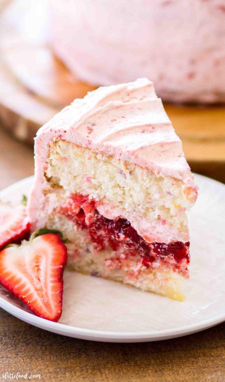 Homemade funfetti strawberry cake with fresh strawberry filling and strawberry frosting on top