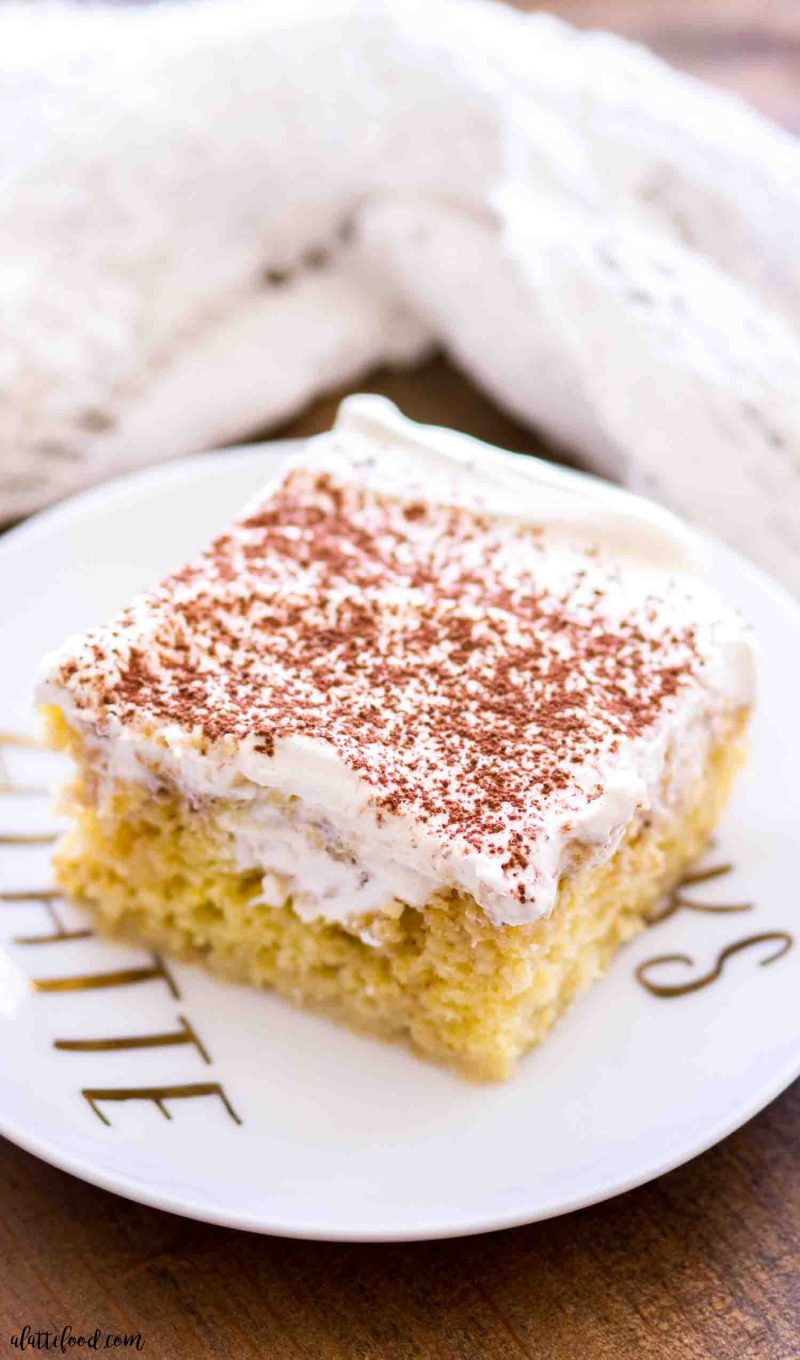 This homemade tiramisu cake on a white plate is the best dessert for any coffee lover!