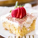 A slice of this easy tiramisu poke cake is a fun twist on a classic coffee recipe!