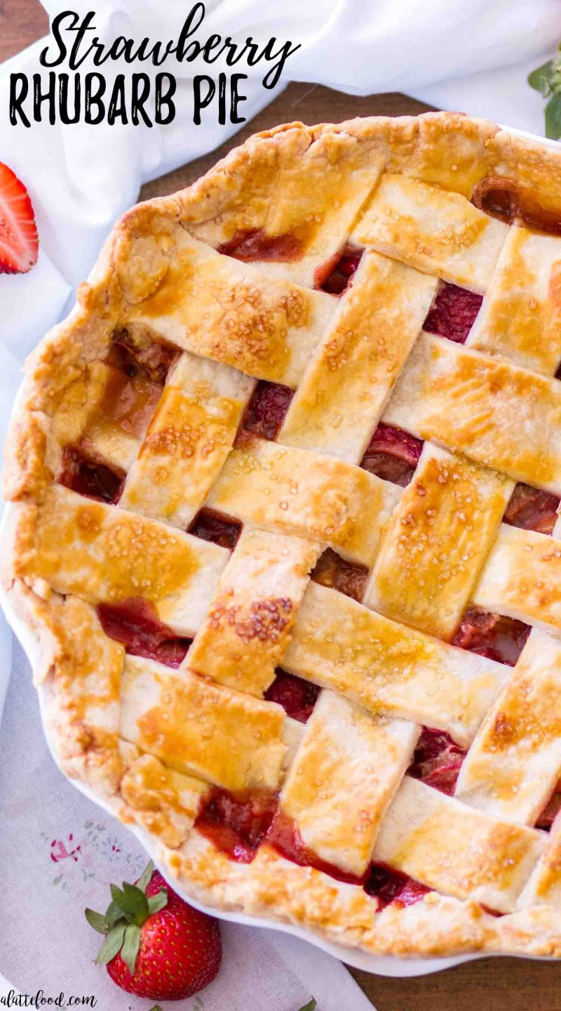 Homemade strawberry rhubarb pie (in a blue pie plate) with a lattice crust