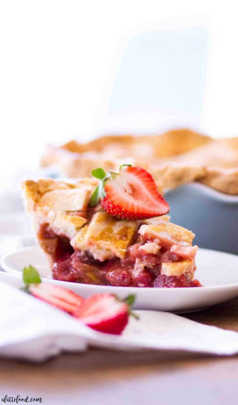 Easy homemade strawberry rhubarb pie slice with an all butter pie crust