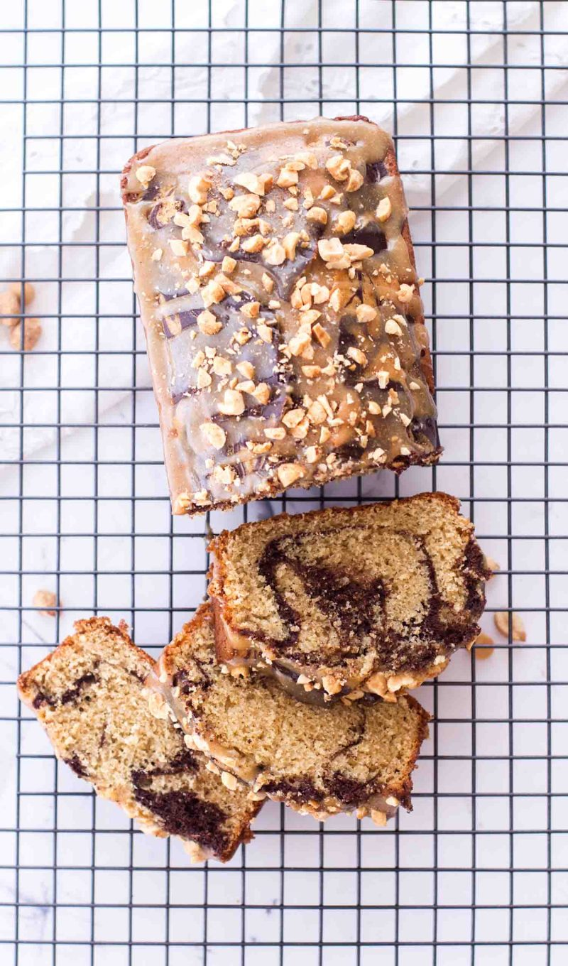 The best chocolate peanut butter marble loaf cake on a wire rack
