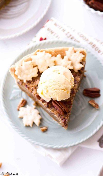Homemade butterscotch pecan pie with vanilla ice cream