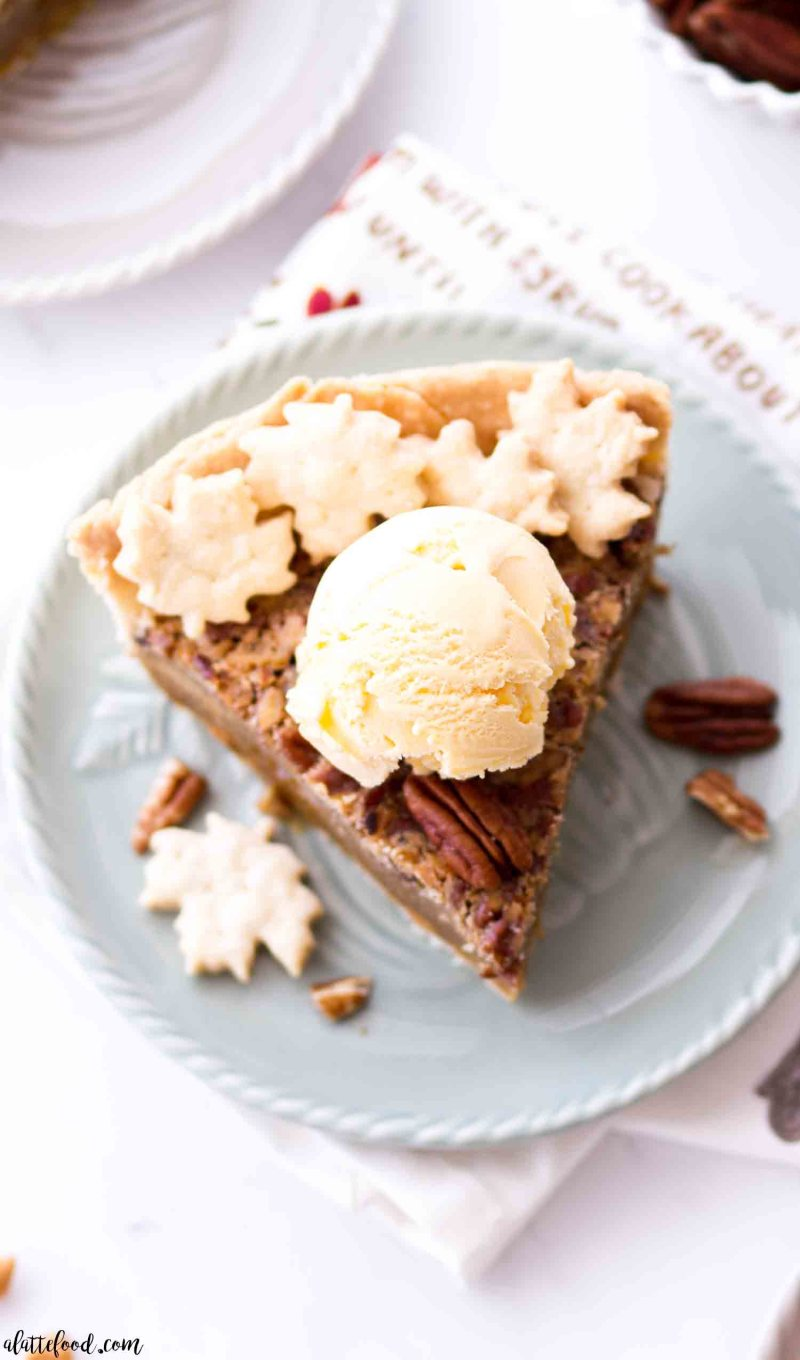 Homemade butterscotch pecan pie with vanilla ice cream