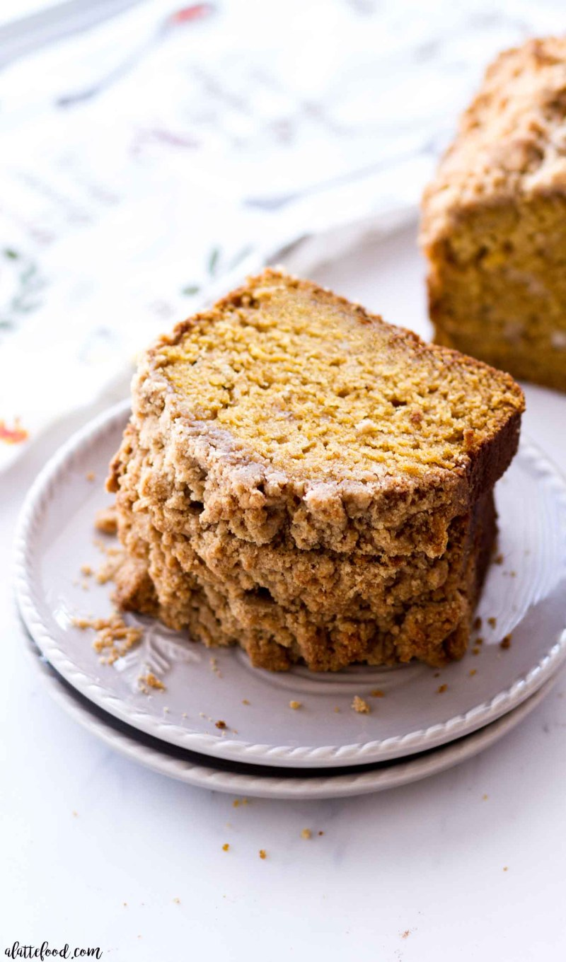 Easy Pumpkin Bread with streusel (crumb cake topping) on a gray plate