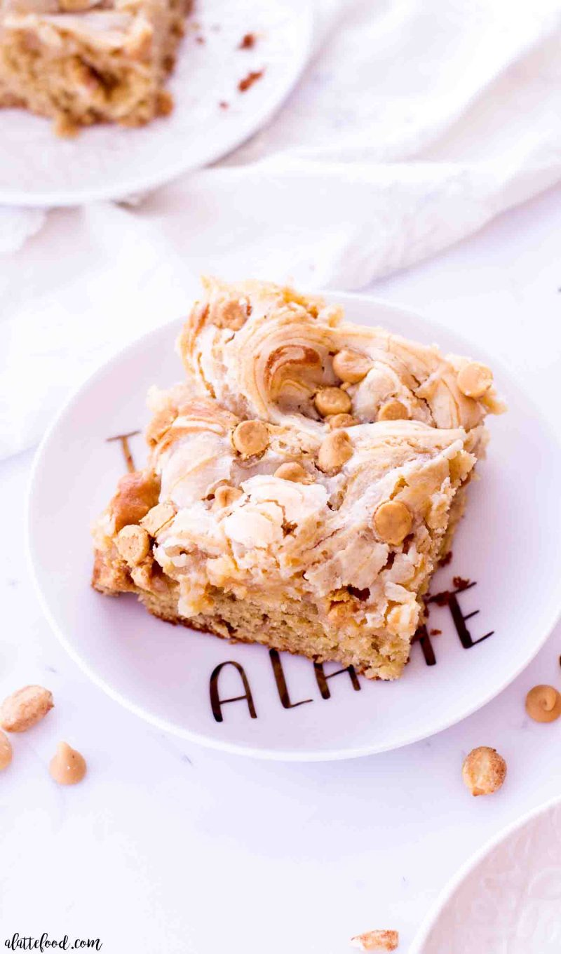 Homemade peanut butter earthquake cake with cream cheese swirls and peanuts