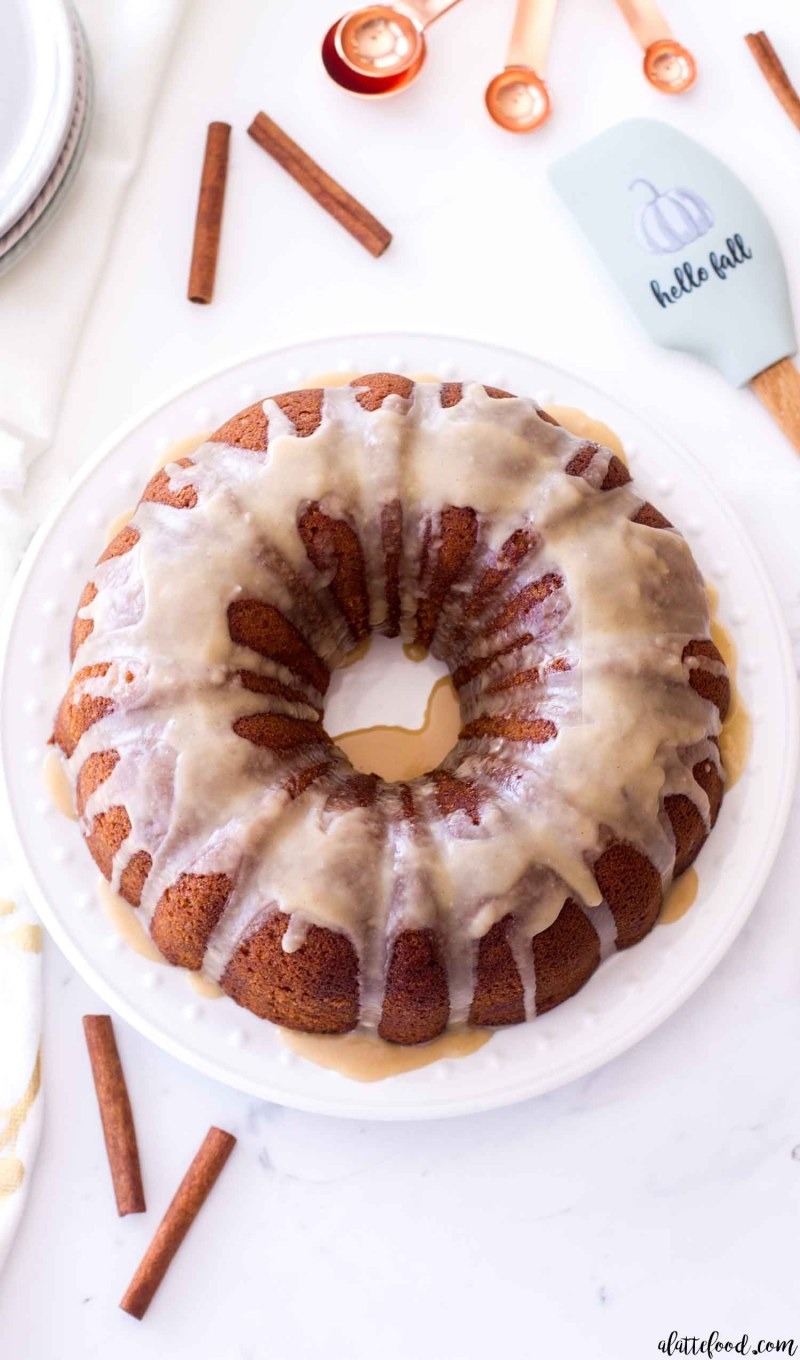 Homemade Vanilla Pumpkin Bundt Cake with maple icing on a white plate