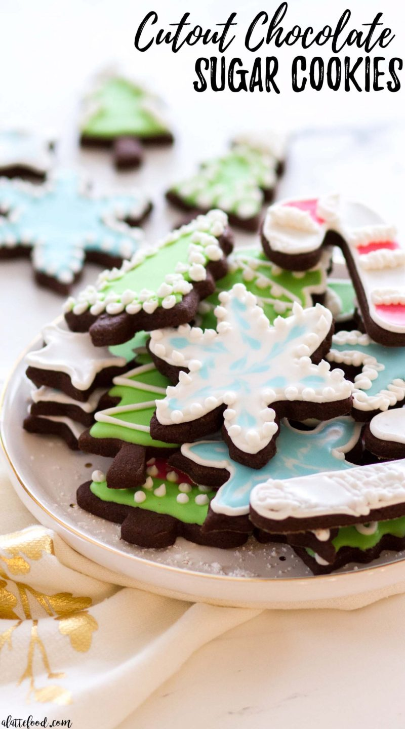 frosted cutout chocolate sugar cookies on white plate