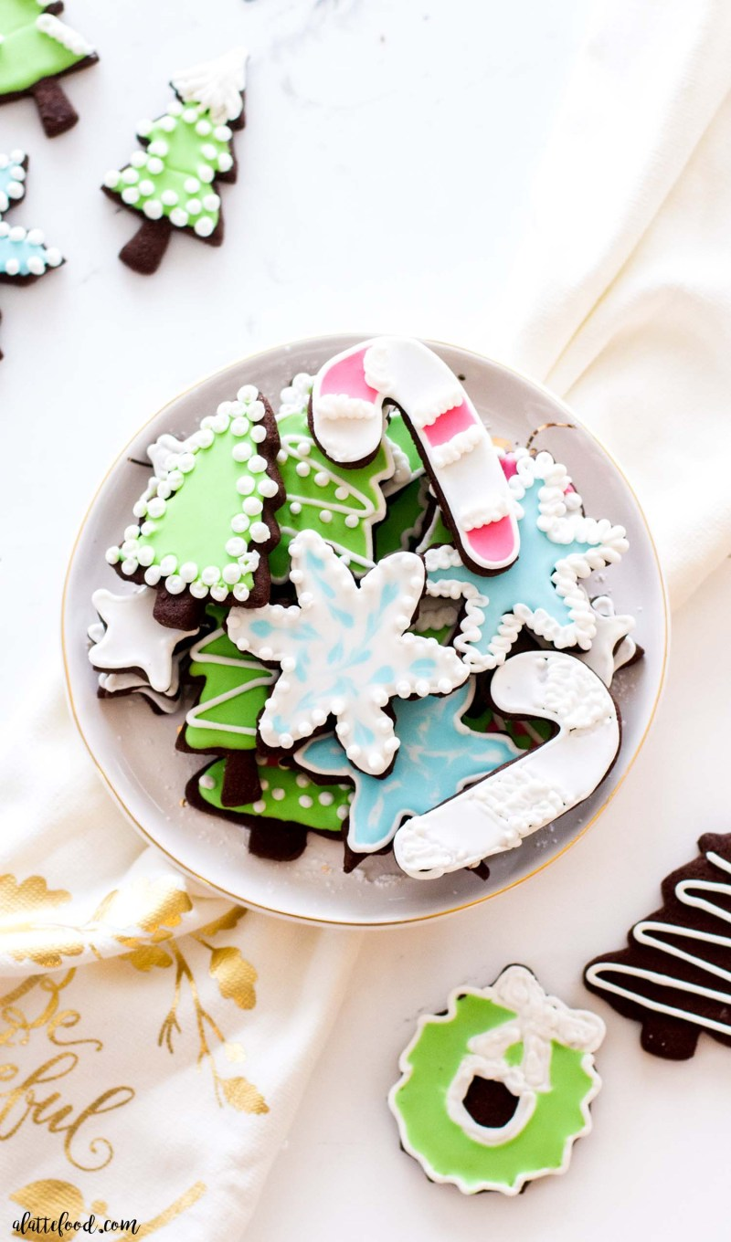 chocolate cutout sugar cookies decorated on a white plate
