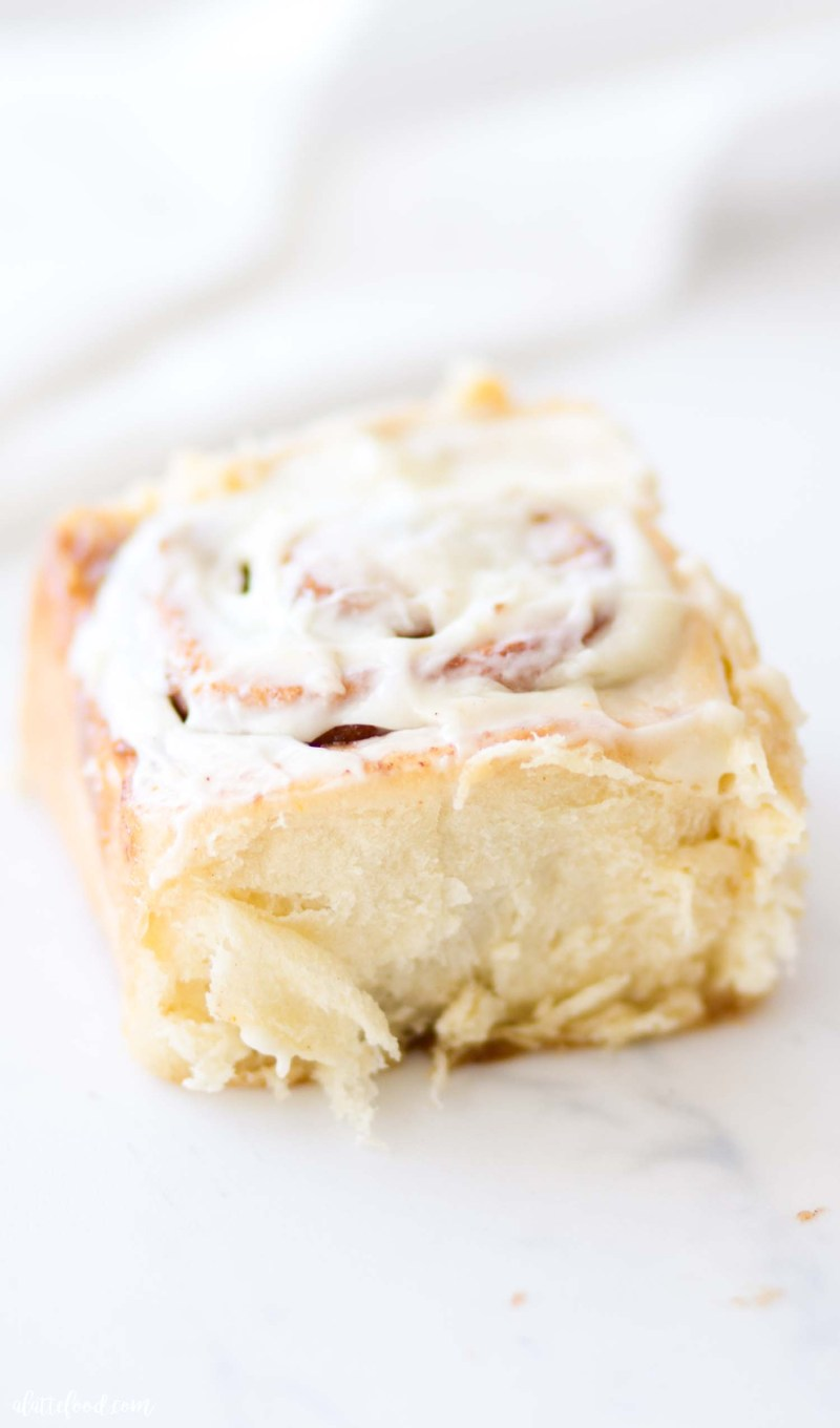 fluffy homemade cinnamon rolls on marble board