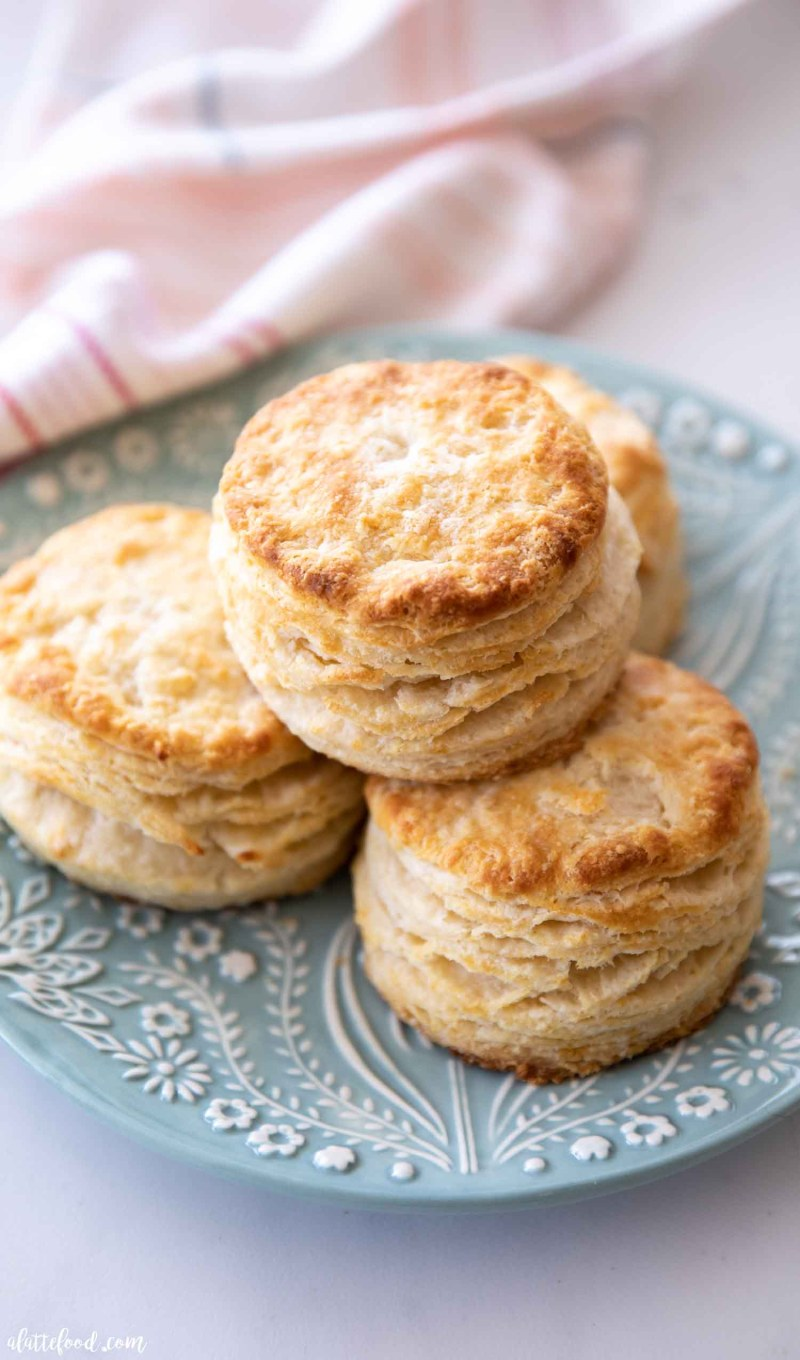 stack of southern biscuits on blue plate