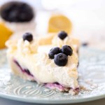 blueberry lemon cream pie slice on blue plate