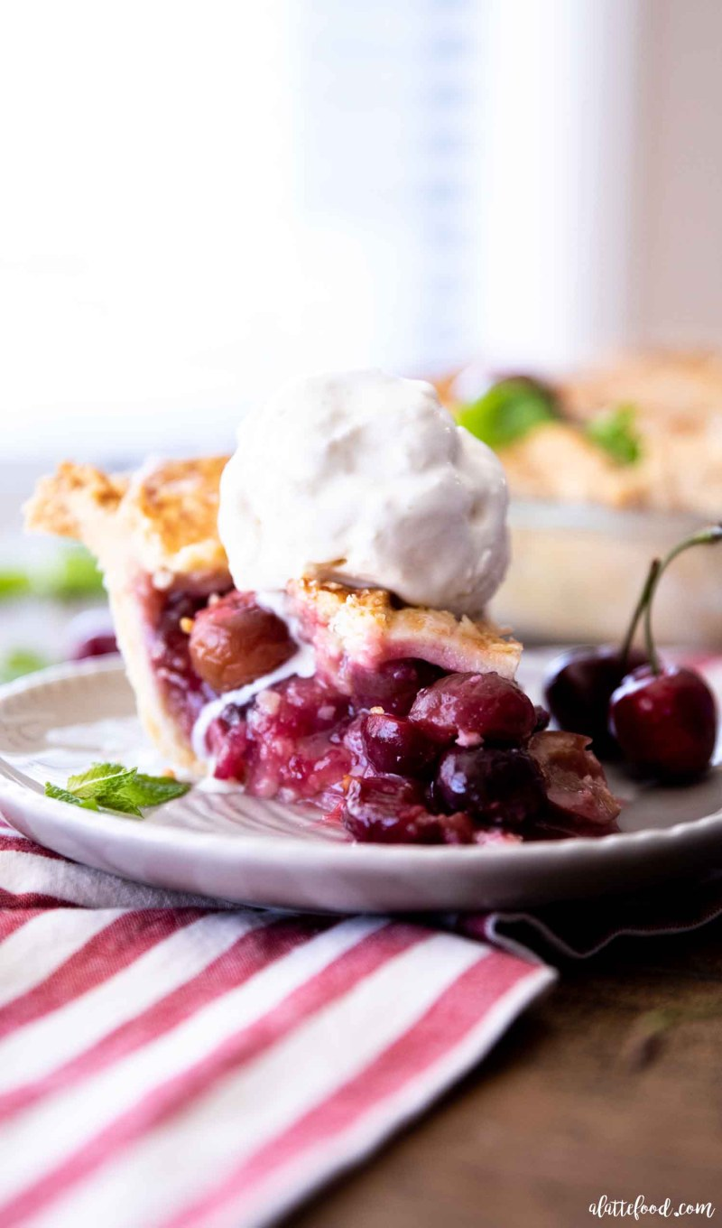 fresh cherry pie slice in a butter pastry crust