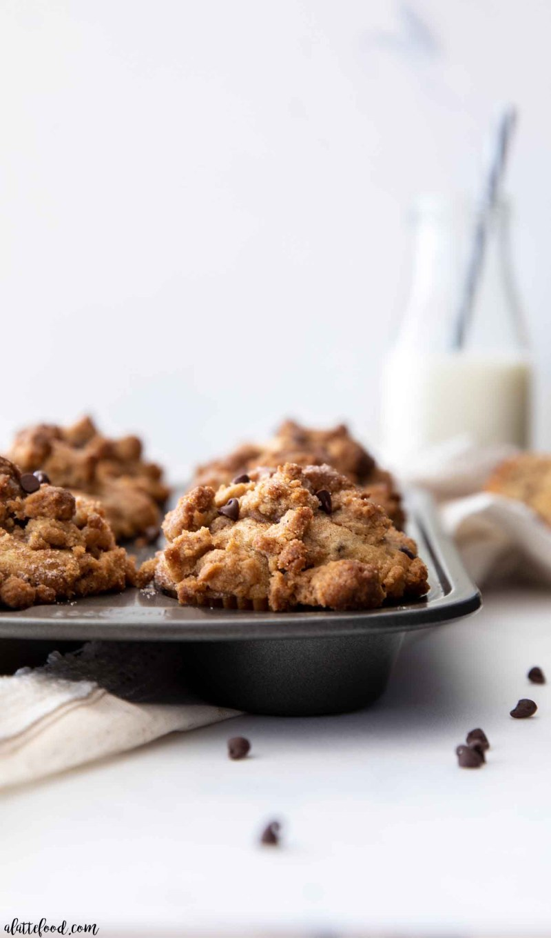 baked chocolate chip crumb cake muffins in metal muffin tin