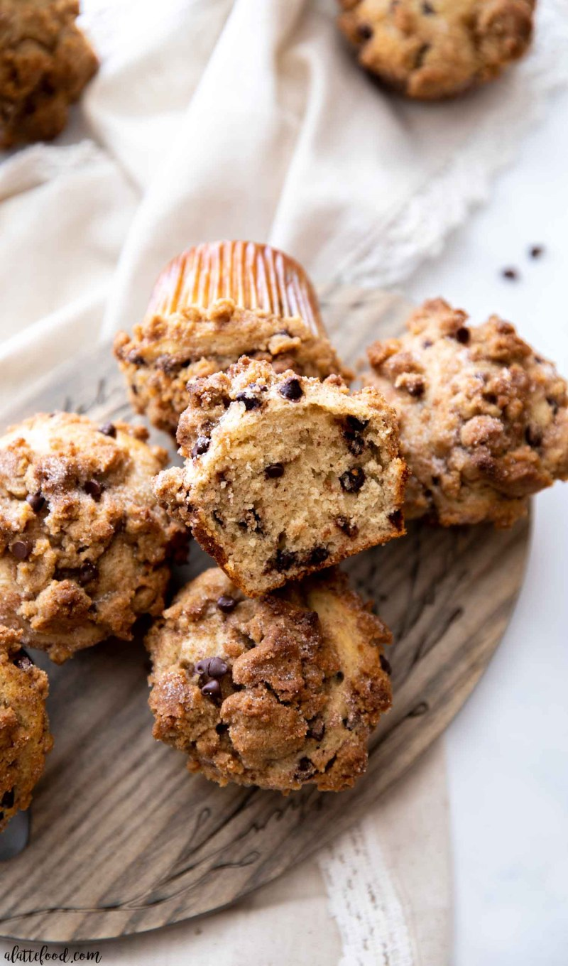 crumb cake chocolate chip muffin half stacked on a wooden board