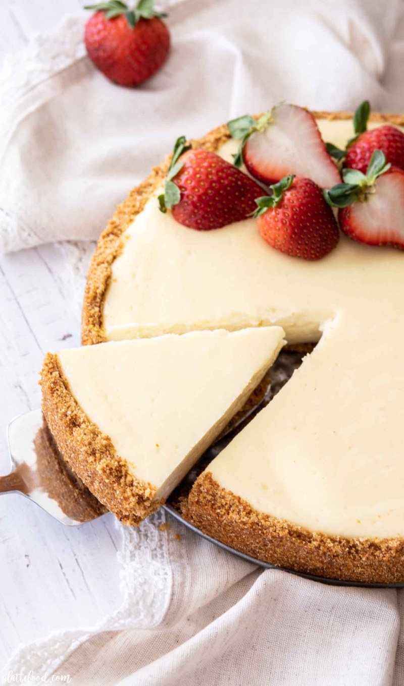 classic cheesecake with strawberries with cut slice