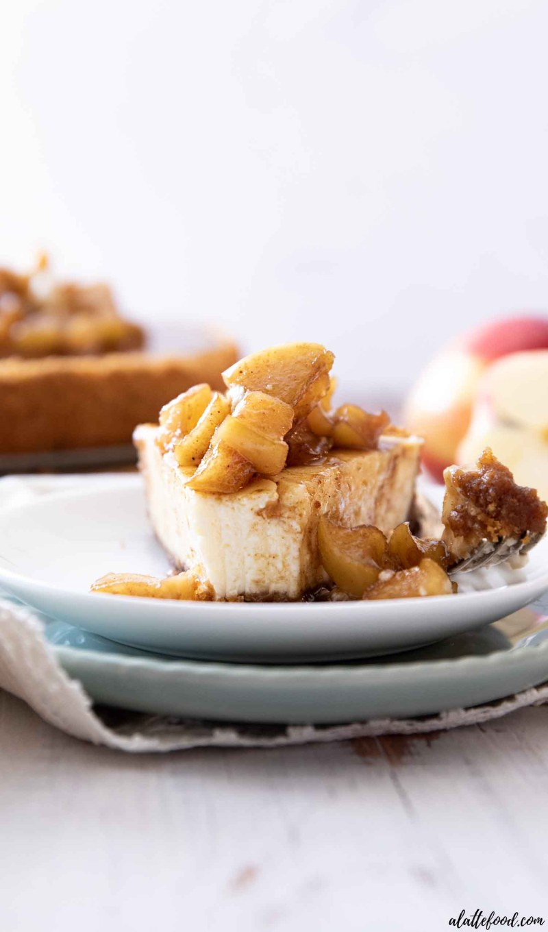 cheesecake slice with fresh caramel apples on top on two plates