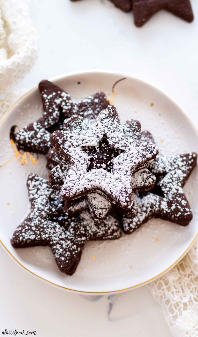 Jam Filled Chocolate Cutout Cookies with powdered sugar on top