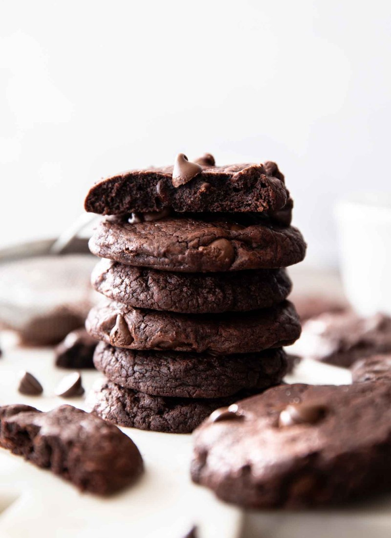stack of fudge chocolate cookies on white board