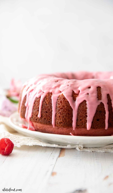up close view of raspberry glaze running down bundt cake