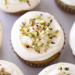 cream cheese frosted cupcakes with pistachios
