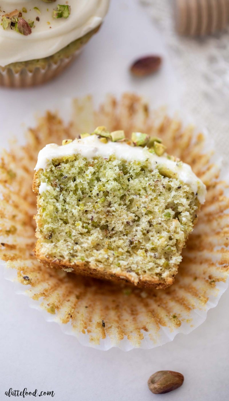 fluffy pistachio cupcake cut in half
