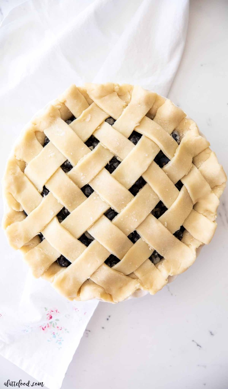 unbaked blueberry pie with a lattice crust