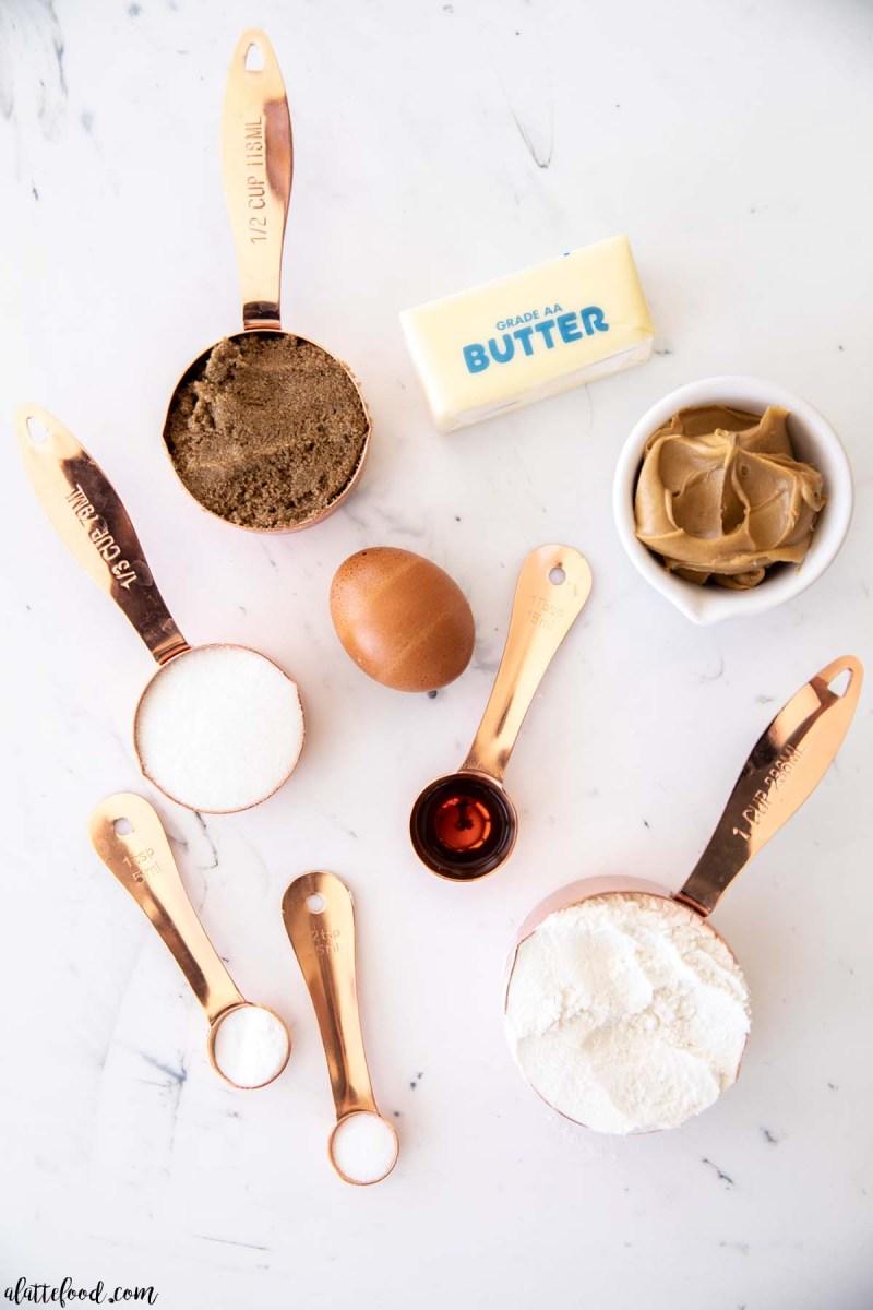 peanut butter cookie ingredients on marble board