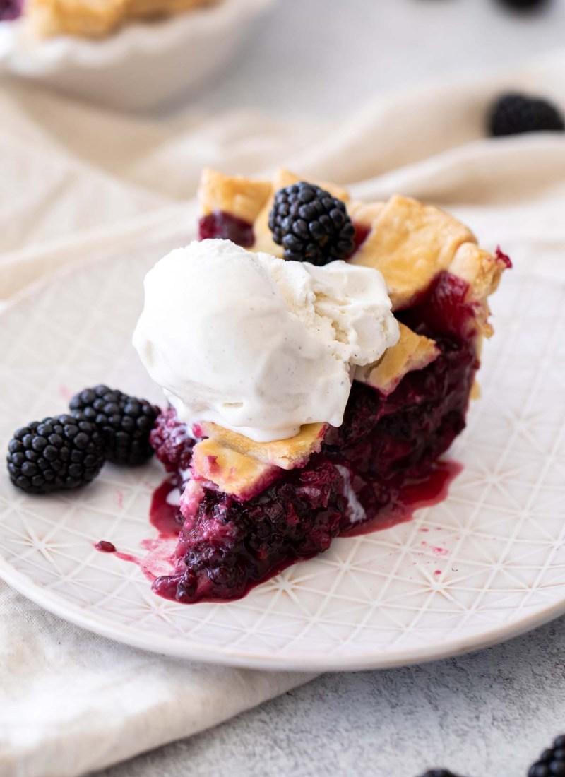slice of fresh blackberry pie with vanilla ice cream