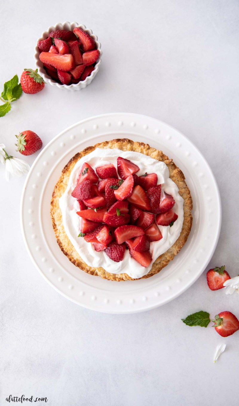 macerated strawberries and whipped cream on one layer of shortcake biscuit
