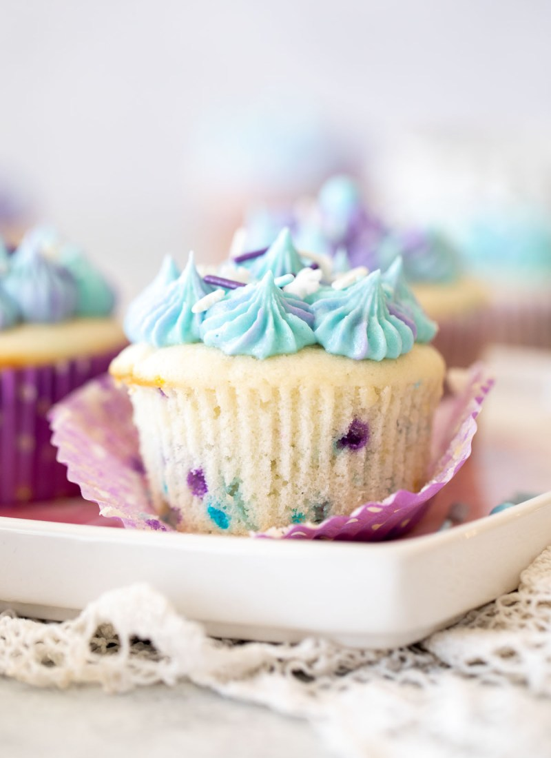 funfetti cupcake made from scratch with purple sprinkles and blue and purple tie dye frosting