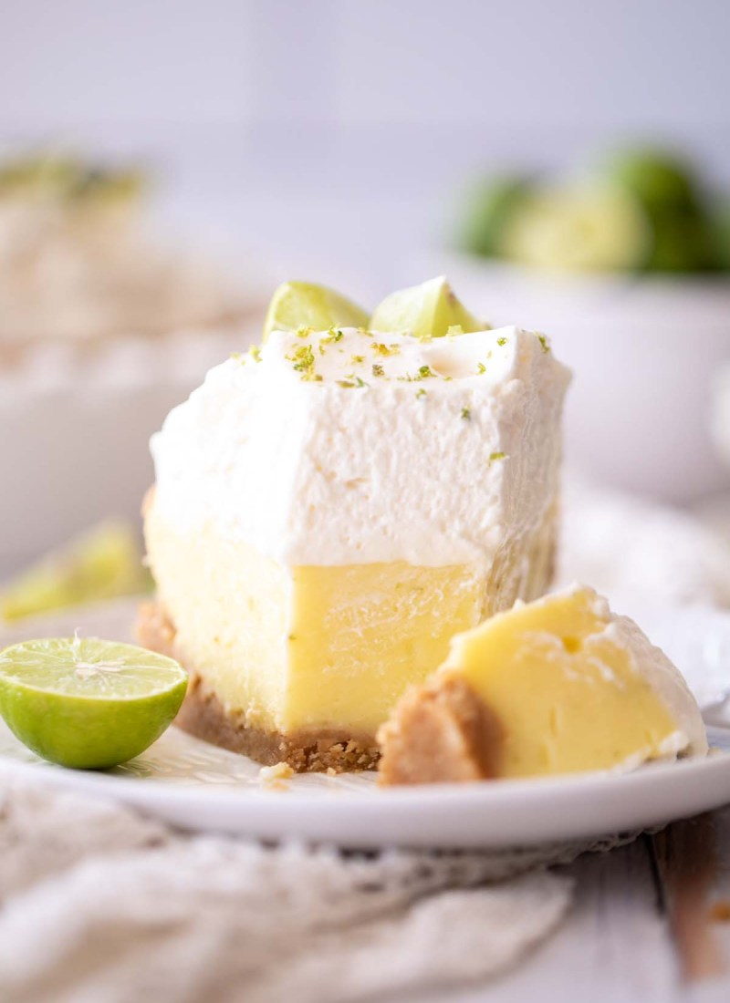 key lime pie slice with a graham cracker crust, custard filling, and whipped cream
