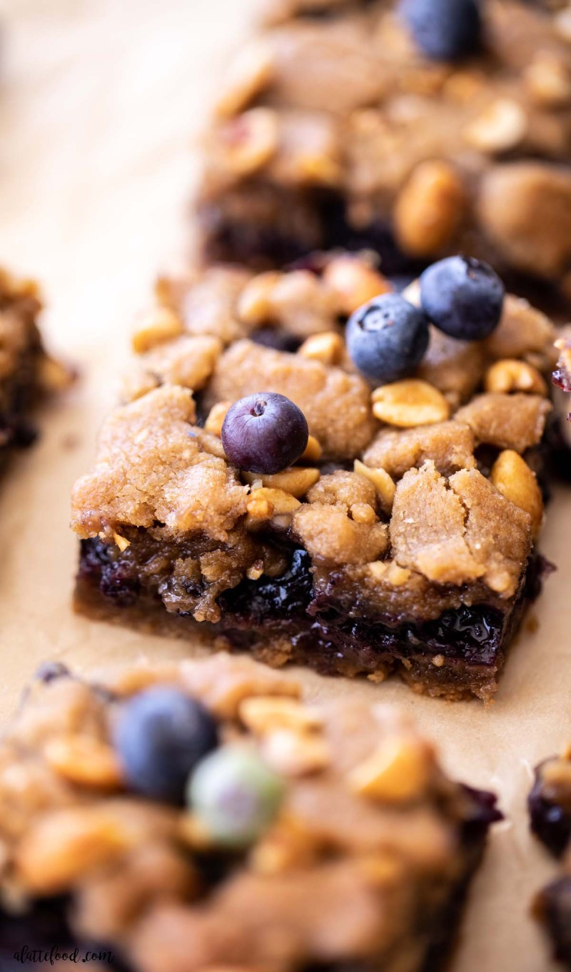 peanut butter and blueberry jelly bar with blueberries on top