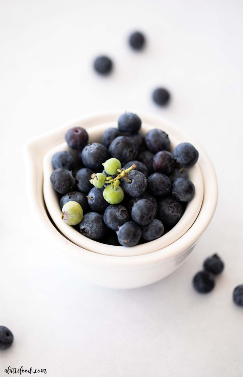 fresh blueberries in a white bowl